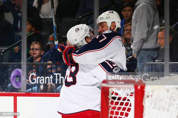 Cam Atkinson of the Columbus Blue Jackets celebrates his game winning overtime goal with teammate Brandon Dubinsky against the New York Islanders at...