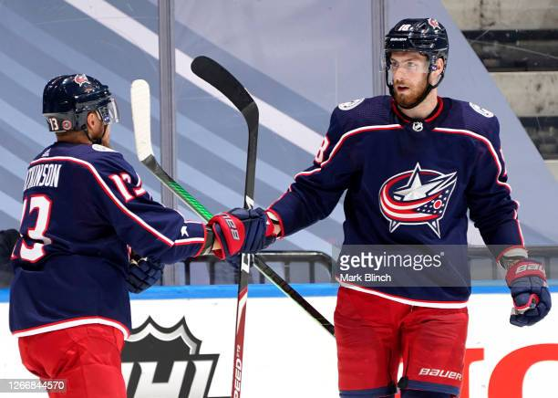 Cam Atkinson of the Columbus Blue Jackets celebrates his goal against the Tampa Bay Lightning with teammate Pierre-Luc Dubois during the second...