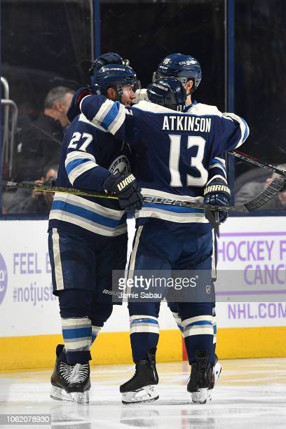 Cam Atkinson of the Columbus Blue Jackets celebrates his second period goal with teammates Ryan Murray and Alexander Wennberg of the Columbus Blue...