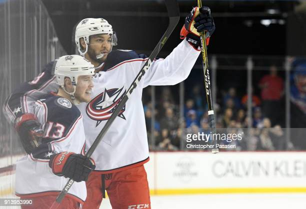 Cam Atkinson of the Columbus Blue Jackets celebrates his secondperiod goal against the New York Islanders with teammate Seth Jones at Barclays Center...