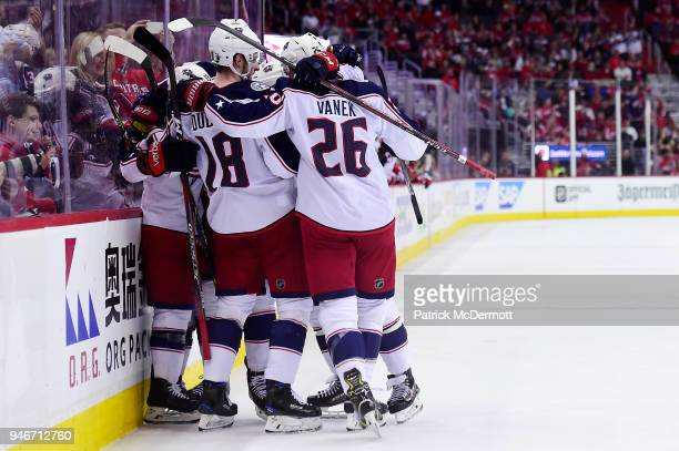Cam Atkinson of the Columbus Blue Jackets celebrates with his teammates after scoring a goal in the second period against the Washington Capitals in...