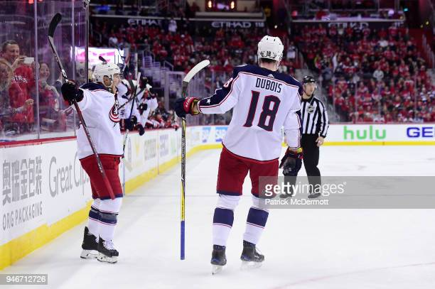Cam Atkinson of the Columbus Blue Jackets celebrates with PierreLuc Dubois after scoring a goal in the second period against the Washington Capitals...