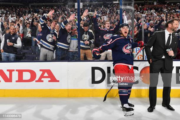 Cam Atkinson of the Columbus Blue Jackets celebrates with the crowd after defeating the Tampa Bay Lightning in Game Four of the Eastern Conference...