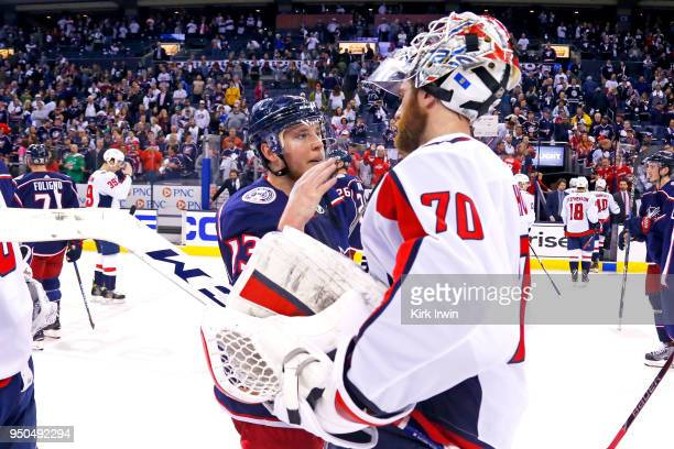 Cam Atkinson of the Columbus Blue Jackets congratulates Braden Holtby of the Washington Capitals at the end of Game Six of the Eastern Conference...