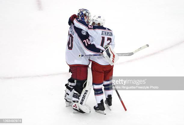 Cam Atkinson of the Columbus Blue Jackets congratulates Joonas Korpisalo after he recorded the team's first shut out after defeating the Toronto...