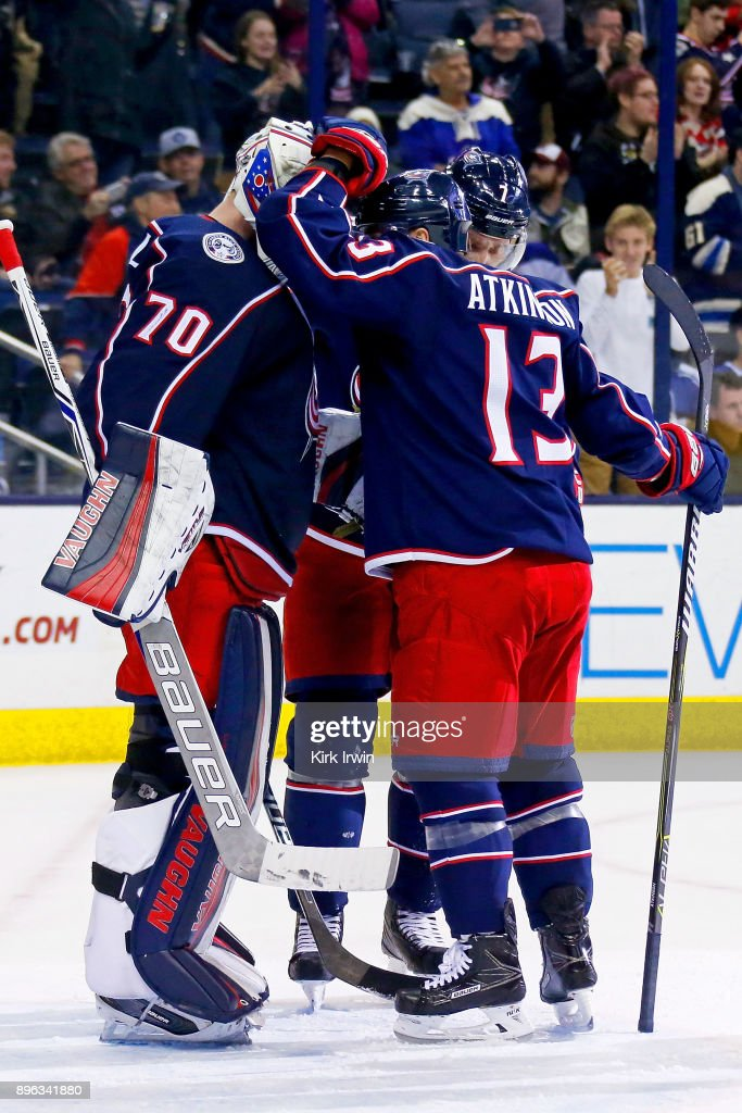 Cam Atkinson #13 of the Columbus Blue Jackets congratulates Joonas Korpisalo #70 of the Columbus Blue Jackets after defeating the Toronto Maple Leafs 4-2 on December 20, 2017 at Nationwide Arena in Columbus, Ohio.