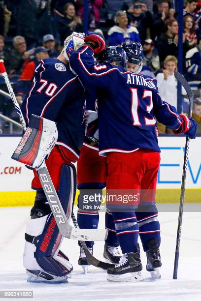 Cam Atkinson of the Columbus Blue Jackets congratulates Joonas Korpisalo of the Columbus Blue Jackets after defeating the Toronto Maple Leafs 42 on...