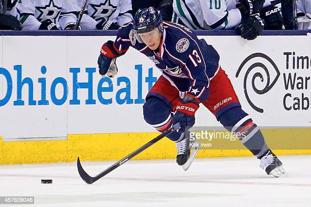 Cam Atkinson of the Columbus Blue Jackets controls the puck during the game against the Dallas Stars on October 14 2014 at Nationwide Arena in...