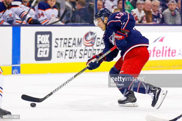 Cam Atkinson of the Columbus Blue Jackets controls the puck during the game against the Edmonton Oilers on December 12 2017 at Nationwide Arena in...
