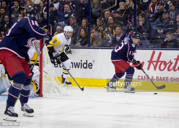 Cam Atkinson of the Columbus Blue Jackets controls the puck during third period of the game between the Columbus Blue Jackets and the Pittsburgh...