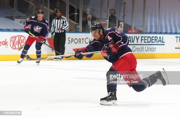 Cam Atkinson of the Columbus Blue Jackets follows through on his shot during the second period of an exhibition game prior to the 2020 NHL Stanley...