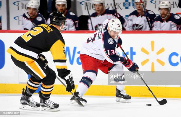 Cam Atkinson of the Columbus Blue Jackets handles the puck against the Pittsburgh Penguins at PPG Paints Arena on December 21 2017 in Pittsburgh...