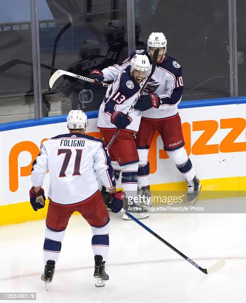 Cam Atkinson of the Columbus Blue Jackets is congratulated by teammates Alexander Wennberg and Nick Foligno after he scored a goal in the third...