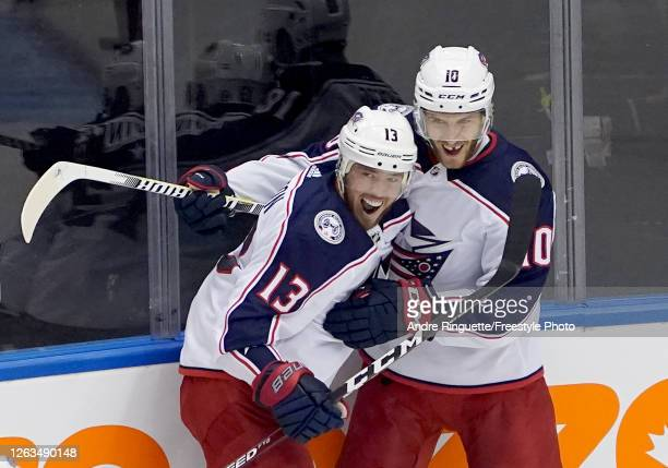 Cam Atkinson of the Columbus Blue Jackets is congratulated by teammate Alexander Wennberg after he scored a goal in the third period against the...