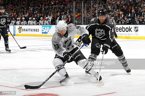 Cam Atkinson of the Columbus Blue Jackets is defended by Joe Pavelski of the San Jose Sharks during the 2017 Honda NHL AllStar Tournament Final...