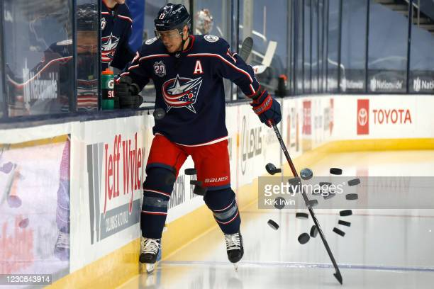 Cam Atkinson of the Columbus Blue Jackets knocks down the stack of warmup pucks prior to the start of the game against the Florida Panthers at...