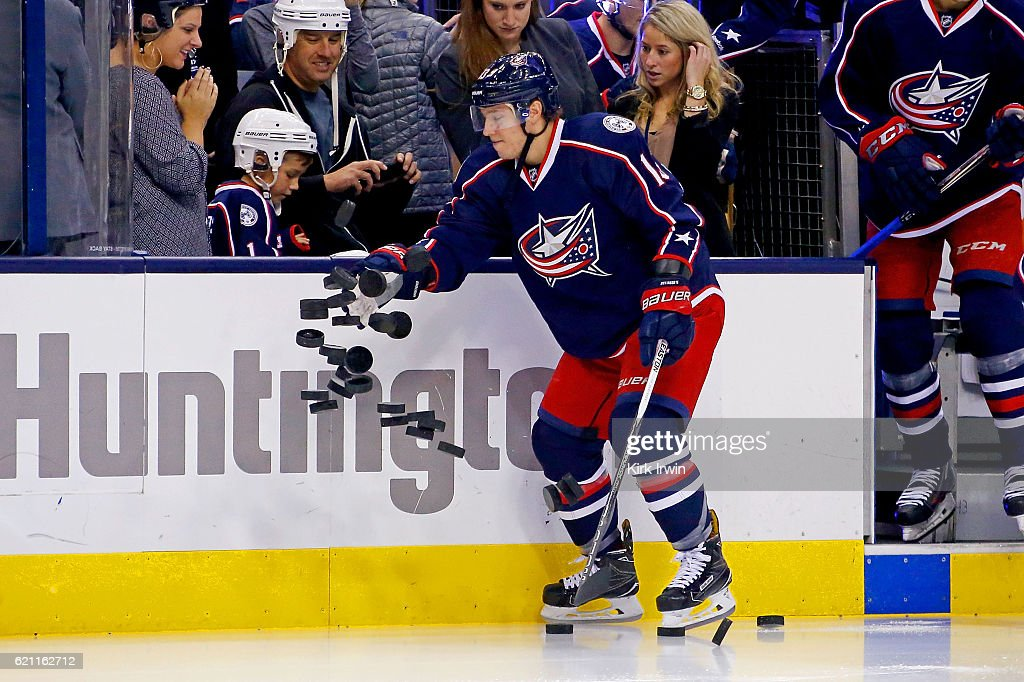 Cam Atkinson #13 of the Columbus Blue Jackets knocks the pucks onto the ice for warmups prior to the start of the game against the Montreal Canadiens on November 4, 2016 at Nationwide Arena in Columbus, Ohio.
