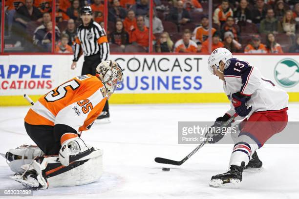 Cam Atkinson of the Columbus Blue Jackets scores a goal on goalie Nick Cousins of the Philadelphia Flyers during the first period at Wells Fargo...