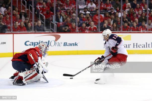 Cam Atkinson of the Columbus Blue Jackets scores a goal on Philipp Grubauer of the Washington Capitals in the first period during Game Two of the...