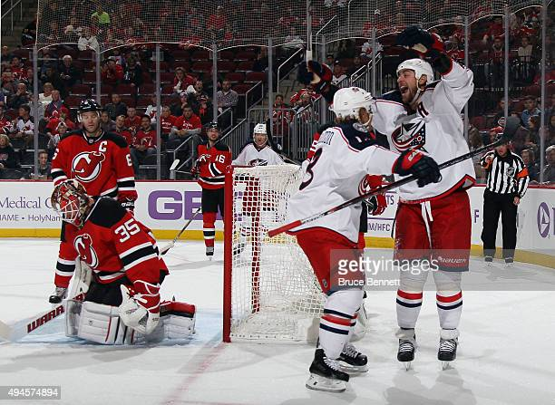Cam Atkinson of the Columbus Blue Jackets scores at 938 and is joined by Brandon Dubinsky in their game against the New Jersey Devils at the...