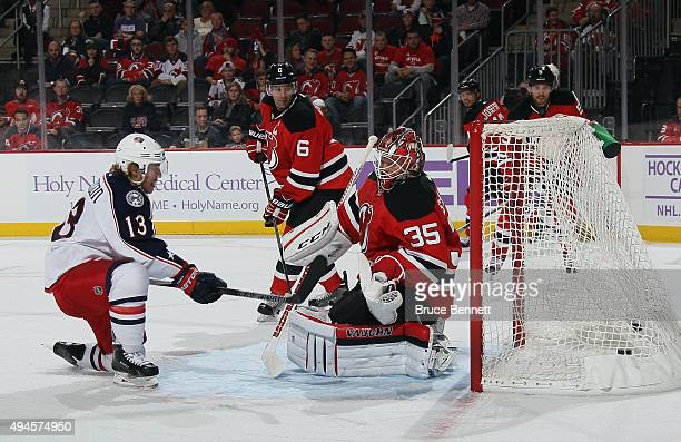 Cam Atkinson of the Columbus Blue Jackets scores at 938 of the third period against Cory Schneider of the New Jersey Devils at the Prudential Center...