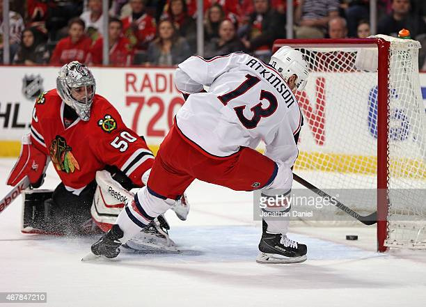 Cam Atkinson of the Columbus Blue Jackets scores his second goal of the first period against Corey Crawford of the Chicago Blackhawks at the United...