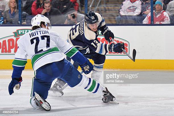 Cam Atkinson of the Columbus Blue Jackets shoots the puck past Ben Hutton of the Vancouver Canucks during the third period on November 10 2015 at...
