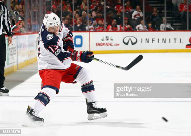 Cam Atkinson of the Columbus Blue Jackets skates against the New Jersey Devils at the Prudential Center on December 8 2017 in Newark New Jersey The...