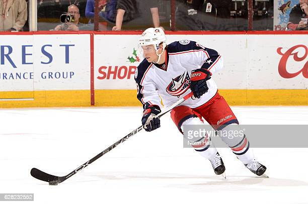 Cam Atkinson of the Columbus Blue Jackets skates with the puck against the Arizona Coyotes at Gila River Arena on December 3 2016 in Glendale Arizona