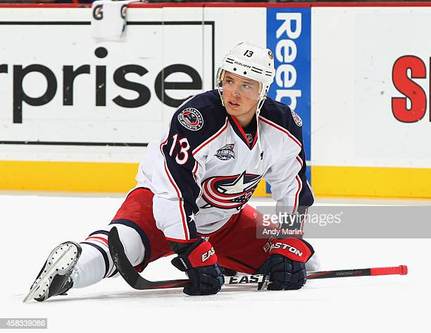 Cam Atkinson of the Columbus Blue Jackets stretches during pregame warmups prior to the game against the New Jersey Devils at the Prudential Center...