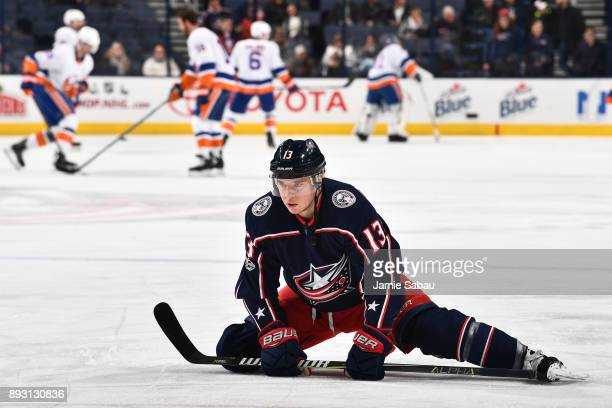 Cam Atkinson of the Columbus Blue Jackets stretches during pregame warmups prior to a game against the New York Islanders on December 14 2017 at...