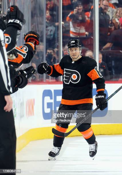 Cam Atkinson of the Philadelphia Flyers celebrates his second period shorthanded goal against the Florida Panthers with his teammates on the bench at...