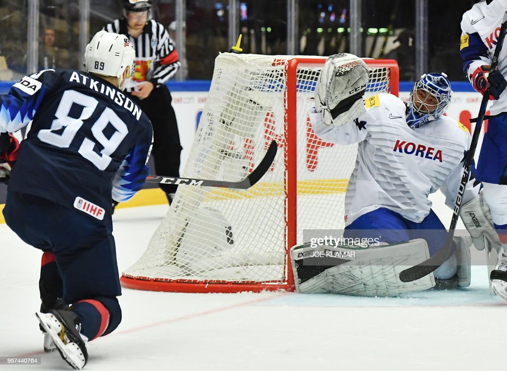 Cam Atkinson of the United States (L) scores past South Korea's Park Sungje during the group B match USA versus South Korea of the 2018 IIHF Ice Hockey World Championship at the Jyske Bank Boxen in Herning, Denmark, on May 11, 2018.