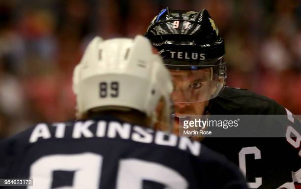 Cam Atkinson of United States faces Connor McDavid of Canada during the 2018 IIHF Ice Hockey World Championship group stage game between United...