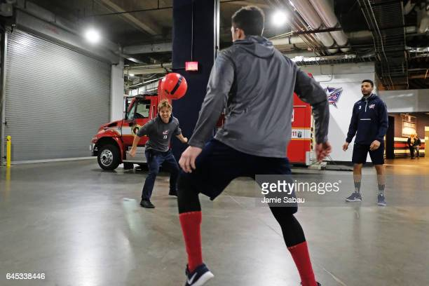 Cam Atkinson Zach Werenski and Seth Jones of the Columbus Blue Jackets warm up with a soccer ball prior to a game against the New York Islanders on...