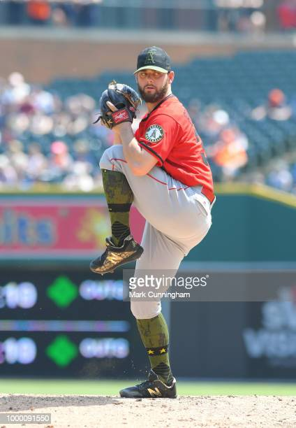 Cam Bedrosian of the Los Angeles Angels of Anaheim pitches while wearing a special jersey hat shoes and socks to honor Memorial Day during the game...