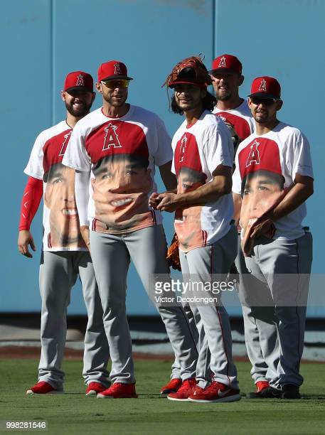 Cam Bedrosian Oliver Drake Noe Ramirez Deck McGuire and Taylor Cole of the Los Angeles Angels of Anaheim look on from the outfield wearing tshirts...