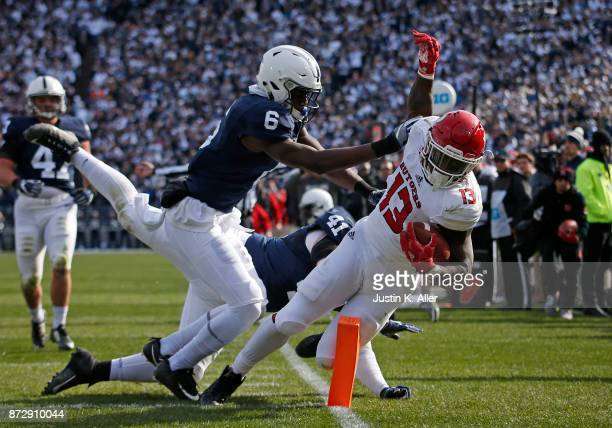 Cam Brown of the Penn State Nittany Lions hits Gus Edwards of the Rutgers Scarlet Knights at Beaver Stadium on November 11 2017 in State College...