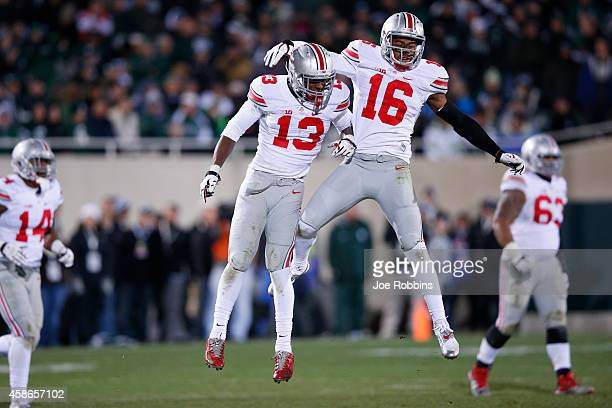 Cam Burrows and Eli Apple of the Ohio State Buckeyes celebrate a defensive stop in the second half of the game against the Michigan State Spartans at...