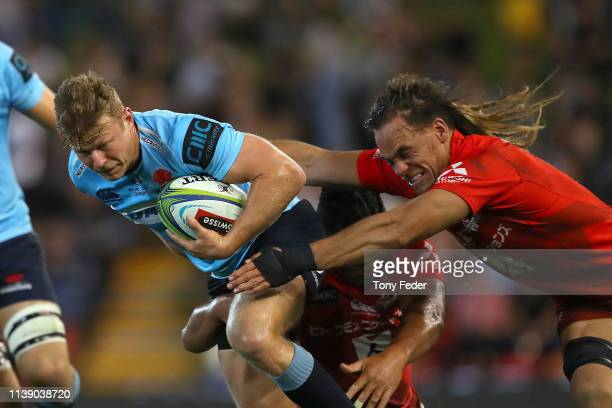 Cam Clark of the Waratahs is tackled by Dan Pryor of the Sunwolves during the round seven Super Rugby match between the Waratahs and the Sunwolves at...