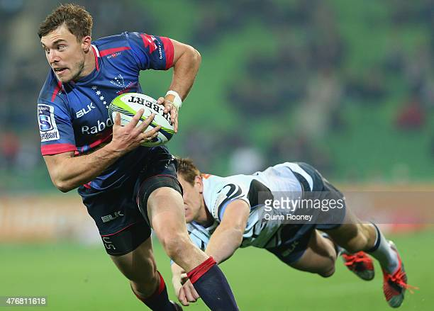 Cam Crawford of the Rebels breaks through a tackle during the round 18 Super Rugby match between the Rebels and the Force at AAMI Park on June 12...