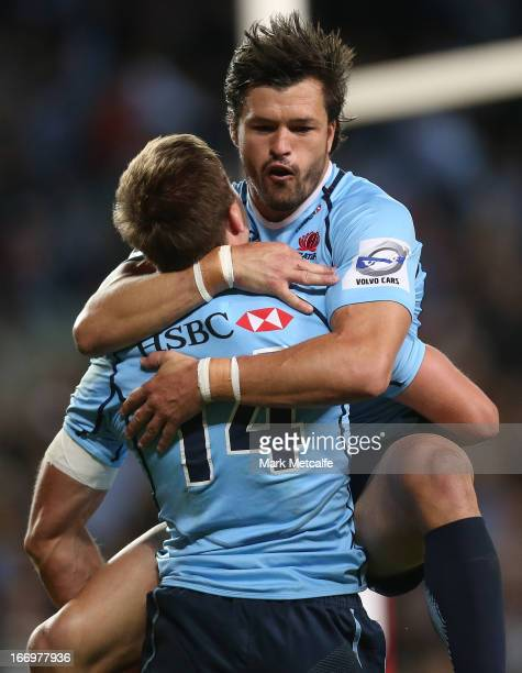 Cam Crawford of the Waratahs celebrates with Adam AshleyCooper after scoring a try during the round 10 Super Rugby match between the Waratahs and the...
