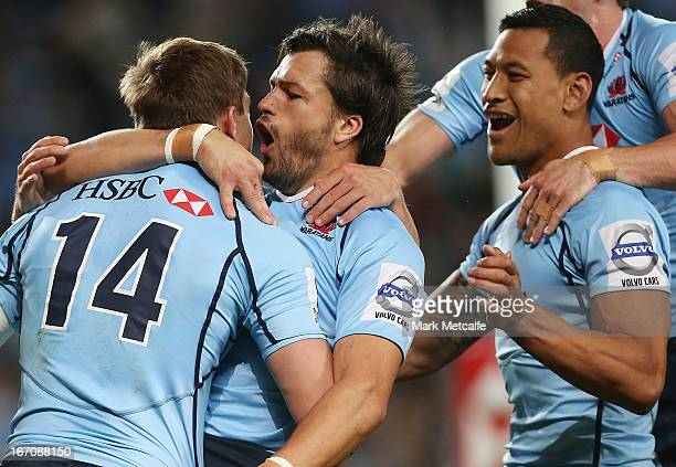 Cam Crawford of the Waratahs celebrates with Adam AshleyCooper and Israel Folau after scoring a try during the round 10 Super Rugby match between the...