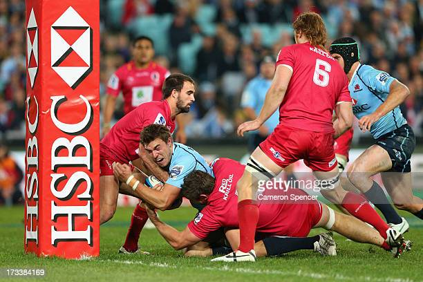 Cam Crawford of the Waratahs scores a try during the round 20 Super Rugby match between the Waratahs and the Reds at ANZ Stadium on July 13, 2013 in...