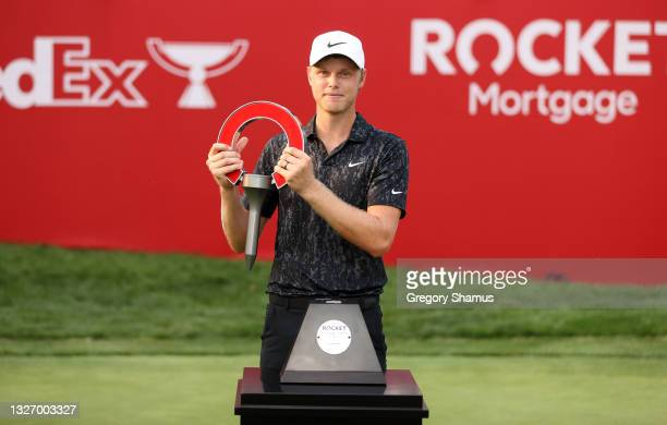 Cam Davis of Australia poses with the trophy after winning on the fifth sudden death playoff hole against Troy Merritt during the final round of the...