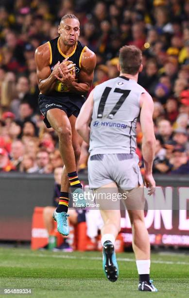 Cam Ellis-Yoleman of the Adelaide Crows marks in front of Sam Rowe of the Blues during the round seven AFL match between the Adelaide Crows and the...