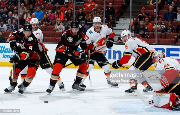 Cam Fowler and Ryan Getzlaf of the Anaheim Ducks battle for the puck against Jaromir Jagr Dougie Hamilton Mark Giordano and Mike Smith of the Calgary...