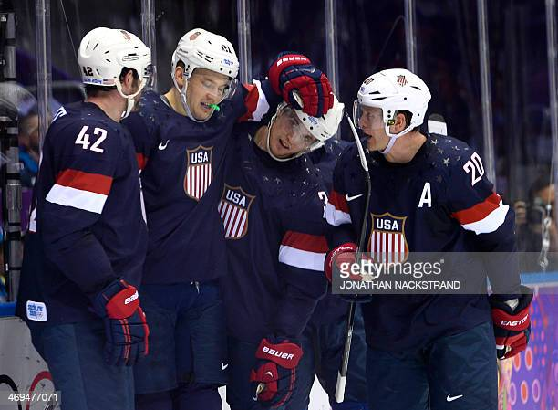 US Cam Fowler celebrates with his teammates after scoring a goal during the Men's Ice Hockey Group A match USA vs Russia at the Bolshoy Ice Dome...