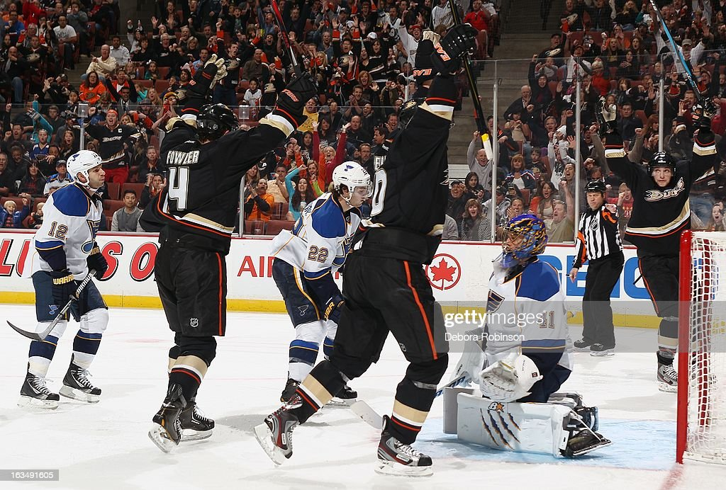 Cam Fowler #4, Corey Perry #10 and Bobby Ryan #9 of the Anaheim Ducks celebrate a score against Scott Nichol #12, Kevin Shattenkirk #22 and goalie Jaroslav Halak #41 of the St. Louis Blues on March 10, 2013 at Honda Center in Anaheim, California.