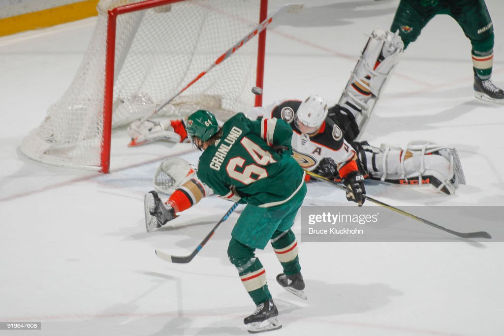 Cam Fowler #4 goalie John Gibson #36 of the Anaheim Ducks defend their goal against a shot but Mikael Granlund #64 of the Minnesota Wild during the game at the Xcel Energy Center on February 17, 2018 in St. Paul, Minnesota.